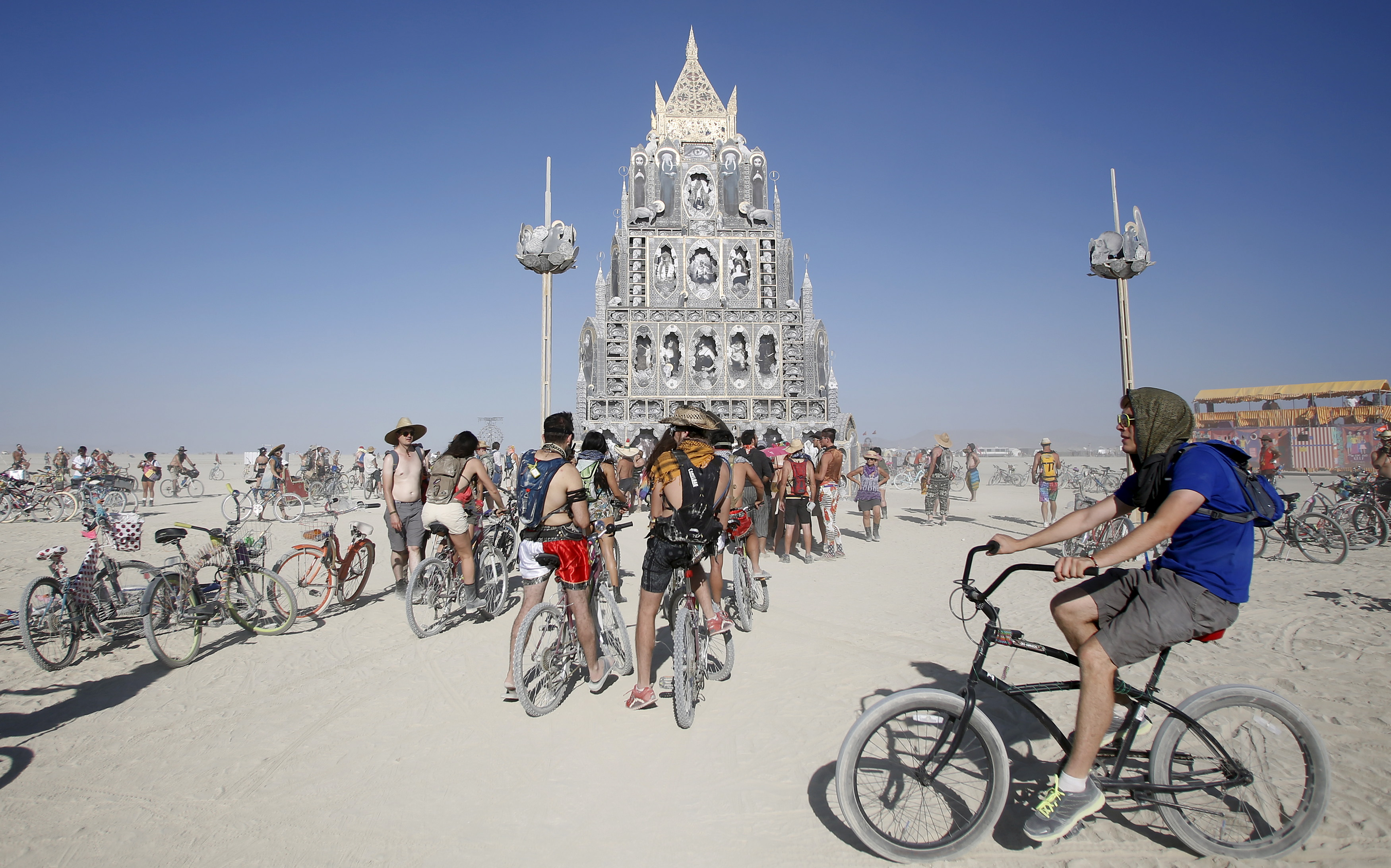 "Participants gather at the art installation ""Totem of Confessions"" during the Burning Man 2015 ""Carnival of Mirrors"" arts and music festival in the Black Rock Desert of Nevada, August 31, 2015. Approximately 70,000 people from all over the world are gathering at the sold-out festival to spend a week in the remote desert to experience art, music and the unique community that develops. REUTERS/Jim Urquhart FOR USE WITH BURNING MAN RELATED REPORTING ONLY. FOR EDITORIAL USE ONLY. NOT FOR SALE FOR MARKETING OR ADVERTISING CAMPAIGNS. NO THIRD PARTY SALES. NOT FOR USE BY REUTERS THIRD PARTY DISTRIBUTORS. - RTX1QIMT"