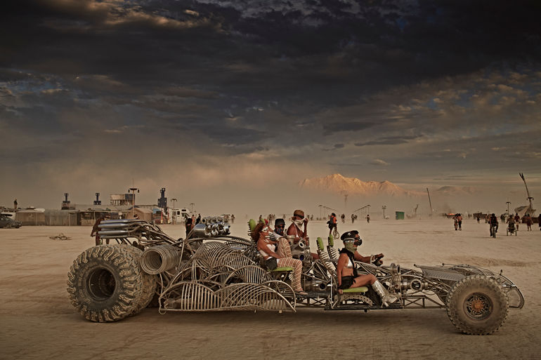 Festival goers ride an art car during the Burning Man festival in Black Rock City, Nevada, United States on August 30, 2014.
